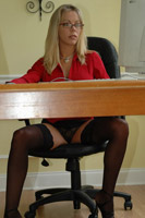 Amber at work, glasses, short skirt, nylons, phone...Everything her co-workers need to get through the day! from Amber at Home