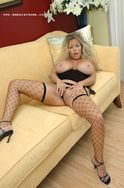 Amber in net stockings showing off her massive rack, bubble butt and pussy. from Amber at Home